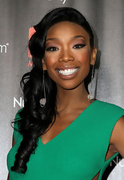 Brandy opted for side swept curls while attending the 2010 Hot List Party. She spiced up her look with gemstone earrings.