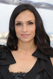 Famke Janssen wore a combo of light metallic and black eye makeup at a Cannes party.