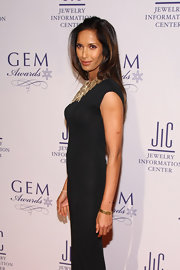 Padma Lakshmi styled her black gown with a gold quartz watch and a statement necklace for the GEM Awards.