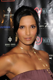 Padma Lakshmi livened up her peepers with amethyst eyeshadow.