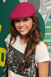 Miley Cyrus donned a fuchsia ivy cap for her appearance on MTV TRL.