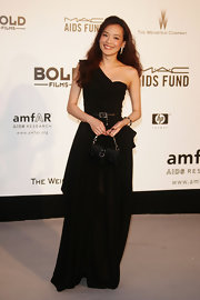 Shu Qi was decked out in her black ensemble wearing a one-shoulder gown with a box purse at the Cinema Against AIDS Benefit.