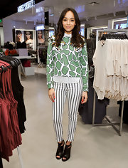Ashley Madekwe walked on the wild side in a giraffe-print, tiger-embroidered sweater by Topshop during the store's LA opening preview.