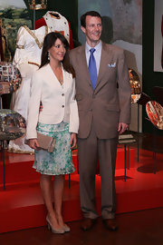 Princess Marie completed her ensemble with a beige leather clutch.