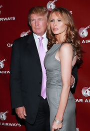 Melania Trump teamed some silver bangles with a sleeveless gray dress for the Qatar Airways gala.