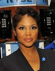 Toni Braxton wore a tousled short 'do at the World Autism Awareness Day event.