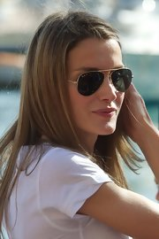Princess Letizia looked beach-ready in a pair of Ray-Ban aviators while visiting the Calanova Sailing School.