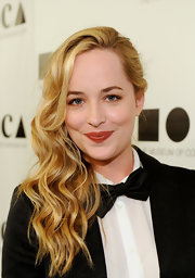 For her outfit, Dakota Johnson went the masculine route with a bow tie and a black coat.