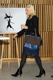 Princess Mette-Marit accessorized with a patterned brown and blue tote at the NHO - Confederation of Norwegian Enterprise conference.