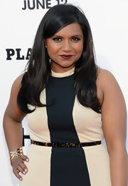 Mindy Kaling styled her dress with a tortoiseshell belt.
