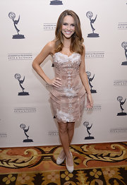 Chrishell Stause complemented her frock with beige mesh platform pumps.