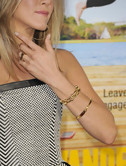 Jennifer Aniston wore a trio of gold bangles to the premiere of 'Wanderlust.'