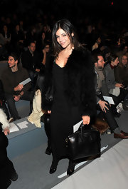 Julia Restoin-Roitfeld attended the Adam fashion show sporting an all-black Givenchy bowler bag, fur coat, and LBD combo.
