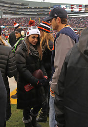 Mila Kunis topped off her cold-weather attire with a pompom beanie.