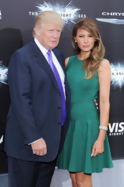 Melania Trump paired a silver and green cuff bracelet with a fit-and-flare dress for the New York premiere of 'The Dark Knight Rises.'