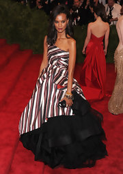 Liya Kebede chose a candy cane-striped Alberta Ferretti one-shoulder gown with fold accents and a voluminous black tulle petticoat for the Met Gala.