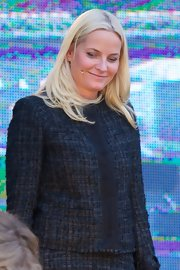 Princess Mette-Marit donned a navy tweed jacket and a matching skirt for the Oslo Book Festival.
