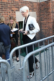Kate Lanphear looked smart in a white cropped jacket with black lapels at the Marc by Marc Jacobs fashion show.