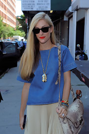 Joanna Hillman glammed up her denim shirt with a chic gold pendant necklace for the Jason Wu fashion show.