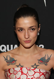 Eleonora Carisi swept her hair up into a classic bun for the screening of 'Behind the Mirror.'