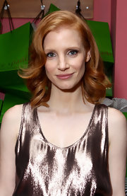Jessica Chastain styled her shoulder-length locks with barrel curls for the Women in Film celebration during TIFF.