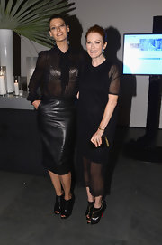 Linda Evangelista combined classy and tough as she pulled off a sheer top and a leather pencil skirt at the WSJ Magazine's Innovator of the Year Awards.