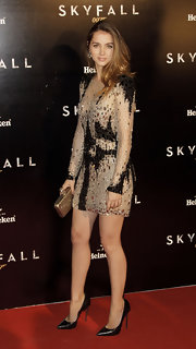 Ana de Armas paired a metallic gold clutch with a beaded mini dress for the Madrid premiere of 'Skyfall.'