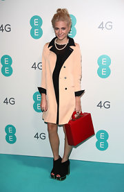 Pixie Lott was office-chic in her pale peach coat and red briefcase combo at the EE launch.