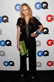 Leelee Sobieski added a splash of color to her look with a stylish green crocodile clutch.
