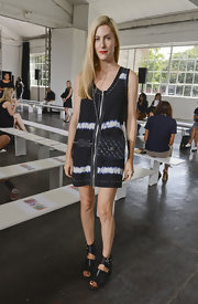 Joanna Hillman styled her casual dress with a classic black quilted bag by Chanel.