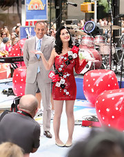 Gold ballet flats finished off Katy Perry's attire.