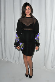 Julia Restoin-Roitfeld accessorized with a Givenchy satin clutch that matched the print on her sleeves.