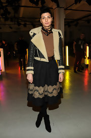 Giovanna Battaglia opted for a pair of black lace-up ankle boots to complete her ensemble.