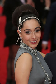 Oona Chaplin accessorized with a beaded headband.