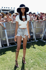 Chanel Iman flashed her cleavage and belly button in a white cutout crop-top during day 2 of Coachella.