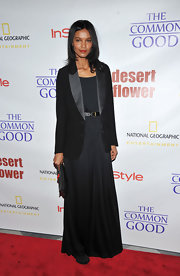 Liya Kebede was subdued and conservative in a black tux jacket layered over a maxi dress at the screening of 'Desert Flower.'