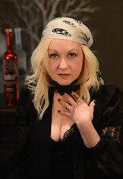 Cyndi Lauper wrapped her head with an Alexander McQueen skull printed bandana at a press conference.
