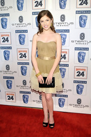 For her footwear, Anna Kendrick kept it simple with black patent platform peep-toes.