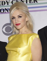 Gwen Stefani's raspberry lipstick provided a striking contrast to her bright yellow dress.
