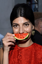 Giovanna Battaglia sweetened up her look with a pair of dangling heart and bow earrings.