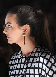 Camilla Belle attended the Michael Kors fashion show wearing her hair pulled back in a classic ponytail.