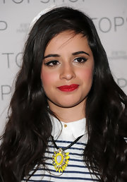 Camila Cabello rocked a bold red lip at the X Factor Topshop photocall.