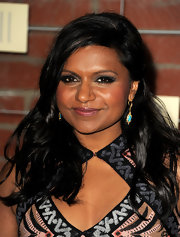 Mindy Kaling pulled her look together with a pair of dangling turquoise earrings.