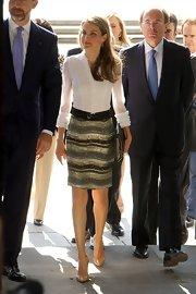 Princess Letizia looked radiant in a white ruffle button-down and a beaded pencil skirt while attending a concert.