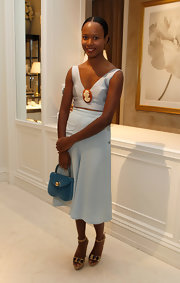 Shala Monroque adorned her crop-top with a classic cameo brooch.