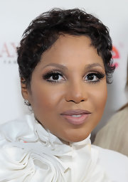 Toni Braxton sported a mussed-up short 'do at the 'Braxton Family Values' celebration.