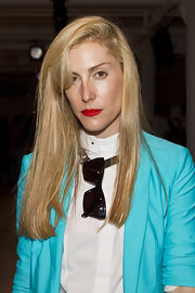 Joanna Hillman wore her hair long and straight with side-swept bangs during the Suno fashion show.