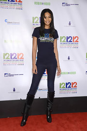 Chanel Iman's knee-high fur and leather boots provided a punchy finish to her tee and jeans combo at the 12-12-12 concert.