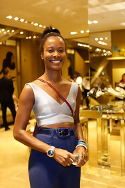 Shala Monroque teamed a white crop-top with high-waisted pants for Miu Miu's celebration of Fashion's Night Out.