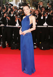 Shu Qi cut a striking figure in her deep blue halter gown with cutout details at the 'My Blueberry Nights' premiere at the Cannes Film Festival.